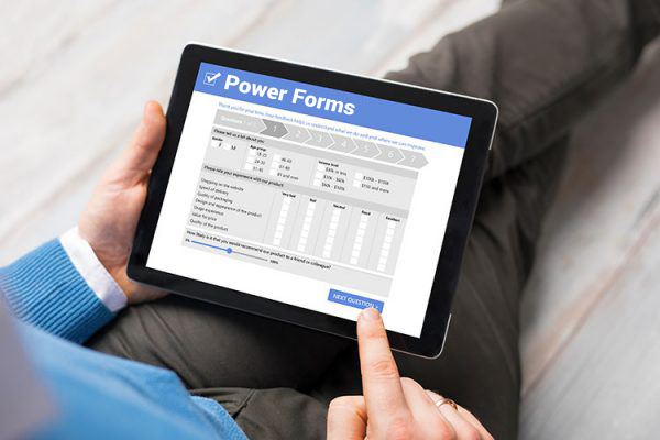 tablet computer in hands displaying Power Forms screen