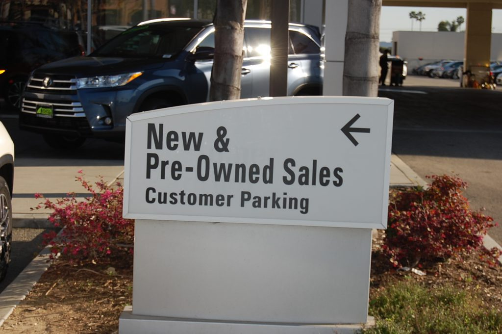 New & Pre-Owned Sales sign