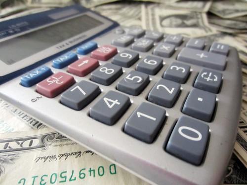 Small calculator on dollar bills